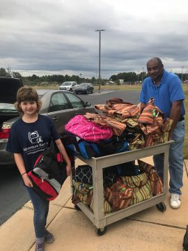Kelsey Norris ~ Jr. Ambassador For Adventure Bags delivering bags to DFACS.