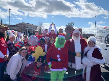 The Adventure Bags Family participating in the Winder Christmas Parade.